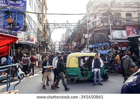 DELHI, INDIA - JANUARY 5, 2015: Local people on street on January 5, 2015 in Delhi, India - stock photo