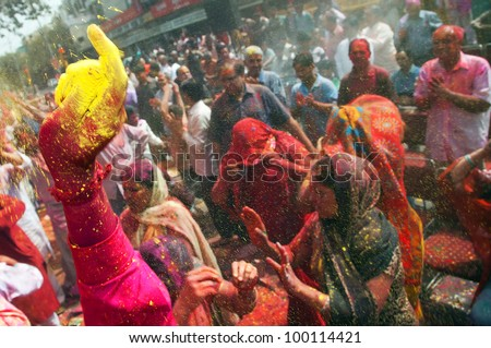 DELHI, INDIA - MARCH 08: People covered in paint on Holi festival, March 08, 2012, Delhi, India. Holi, the festival of colors, marks the arrival of spring, being one of the biggest festivals in India - stock photo