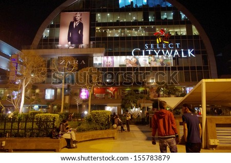 DELHI, INDIA - MARCH 17: Select CityWalk mall on March 17, 2011 in Delhi, India. Select CityWalk is a favourite among the new middle class and is a monument to the emerging economic giant's capital. - stock photo