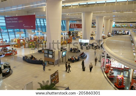Delhi, India- MAY 27 : The main hall of  Delhi Indira Gandhi International airport on May 27, 2014. This airport is the largest airport in India, which was constructed in 2010. - stock photo