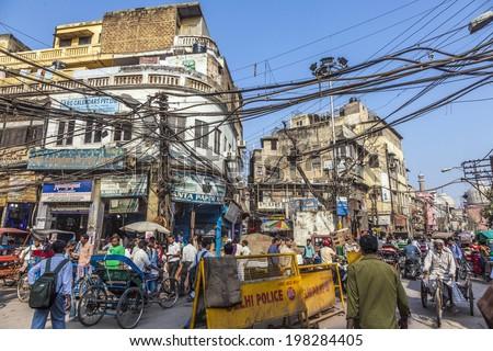 DELHI, INDIA - NOV 9, 2011: people in old Delhi in Chawri Bazaar, the famous old market in Delhi, India. Established in 1840, it was the first wholesale market of Old Delhi - stock photo
