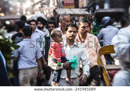 DELHI, INDIA - NOVEMBER 10: Morning on a street at November 10, 2013 in Old Delhi, India. Indian capital still uses man powered rickshaws as a usual mean of transport - stock photo