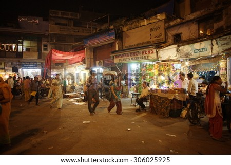 DELHI, INDIA - NOVEMBER 2: People are busy with daily activities on famous Main Bazaar Road on November 2, 2013 in Delhi - stock photo