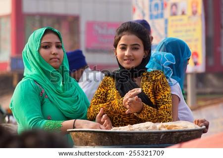 DELHI, INDIA - NOVEMBER 5: Unidentified women cook during Guru Nanak Gurpurab celebration on November 5, 2014 in Delhi, India. This festival celebrates the birth of the first Sikh Guru. - stock photo