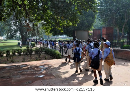 DELHI, INDIA - OCT 24: A group of pupils walk on courtyard of the Red Fort on October 24, 2009 in Delhi. The Red Fort,UNESCO World Heritage, is one of the most popular tourist destinations in Delhi. - stock photo
