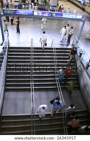DELHI, INDIA - SEPTEMBER 18 : Crowds in the new and modern metro station on September 18, 2007 in Delhi, India. Delhi is the second most populous city in India. - stock photo