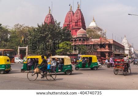 DELHI, INDIA - 19TH MARCH 2016: A view of streets and the Shri Digambar Jain Lal Mandir Temple in Delhi. Lots of Tuk Tuk Rickshaws and traffic can be seen. - stock photo