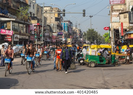 DELHI, INDIA - 19TH MARCH 2016: Roads and streets of Delhi during the day. People on bikes, Tuk Tuks and pedestrians can be seen. - stock photo