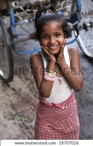 DELHI - MAY 25: Indian street girl smiling. May 25 2006 in Old Delhi, India - stock photo