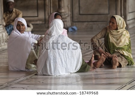 DELHI - SEPTEMBER 19: Unknown women sitting on the floor of the Jama Masjid (Friday Mosque) September 19, 2006 in Old Delhi, India