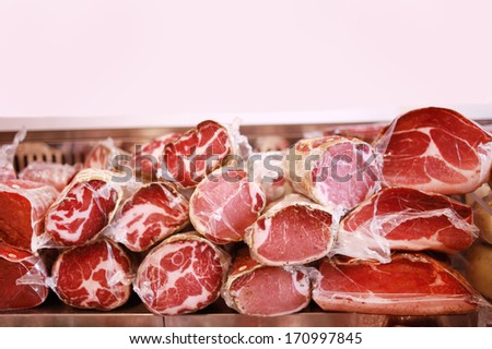 Deli display cold meat and salami, with copy space - stock photo