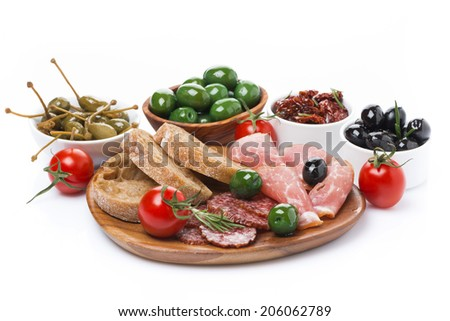 deli meats, pickles and olives on a wooden board, isolated on white - stock photo