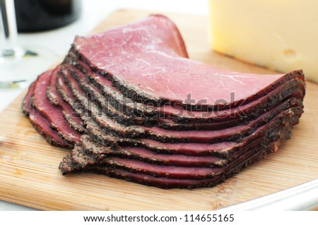 Deli pastrami meat sliced on cutting board horizontal