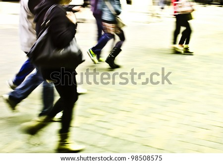 Deliberately blurred people walking action