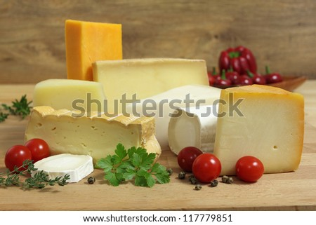 Delicacies. Food composition - cheese varieties and vegetables.