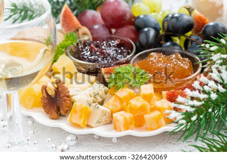delicacy cheese and fruit plate, closeup, horizontal - stock photo