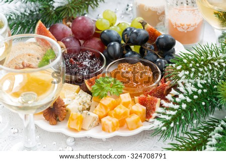 delicacy cheese and fruit plate on table, closeup - stock photo