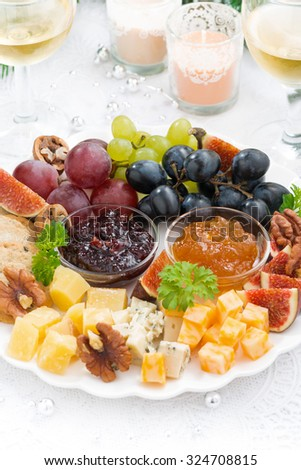 delicacy cheese and fruit plate to the holiday, vertical, closeup - stock photo