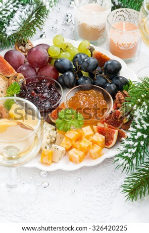 delicacy cheese and fruit plate, vertical, top view, closeup - stock photo