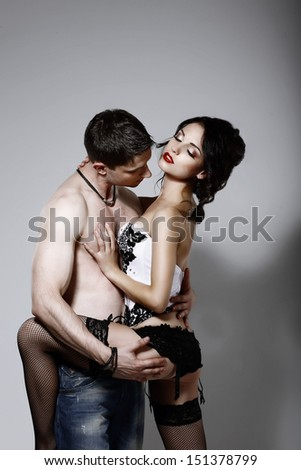 Delicacy & Fondness. Boyfriend and Girlfriend Embracing in Foreplay Game - stock photo