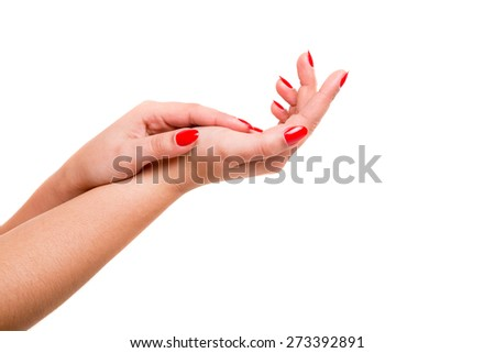Delicate and well-manicured hands being massaged and rubbed together - stock photo