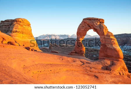Delicate Arch at sunset, one of the most famous rock formation in Utah located in Arches National Park. - stock photo