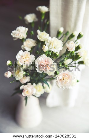 delicate bouquet of carnations in a vase vintage. romance - stock photo