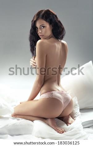 Delicate brunette lady posing in bedroom - stock photo