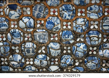 Delicate ceramic and mortar mosaic motifs in the Imperial City, the Citadel, Hue, Vietnam - stock photo