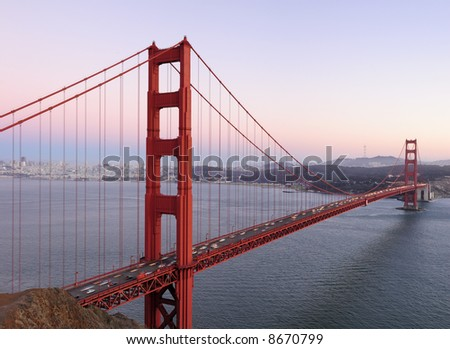 Delicate lilac, pink and purple hues play in the sky behind high-resolution stitched image of Golden Gate Bridge. Copyspace on top right. - stock photo