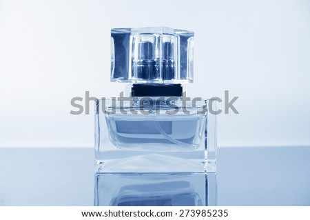 delicate perfume on the mirror surface - stock photo
