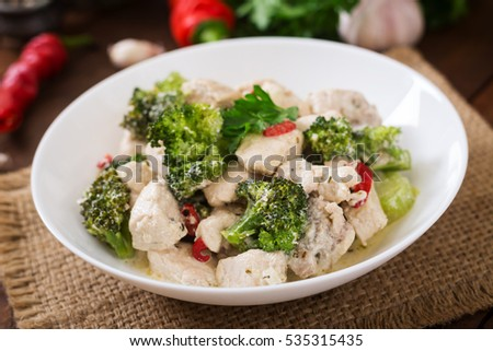 Delicate saute chicken with broccoli and chili peppers in a creamy garlic sauce