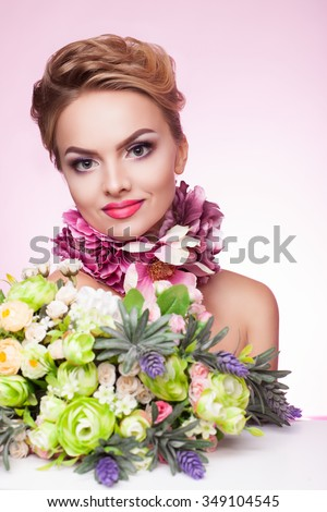 delicate scent of a woman on a pink background with exotic flowers