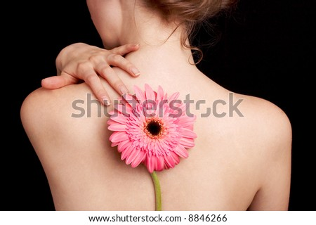 delicate skin, the back of a woman and pink flower, spa treatment - stock photo