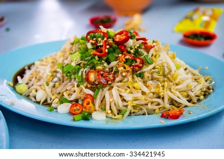 Delicious and appetizing bean sprouts garnished with green onions and chilli - stock photo
