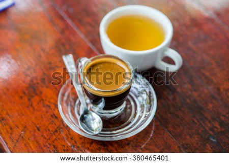 delicious and aromatic Espresso in transparent cups - stock photo