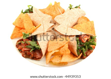 Delicious and colorful mexican fajitas or wraps, and crunchy nacho chips isolated on a white background - stock photo