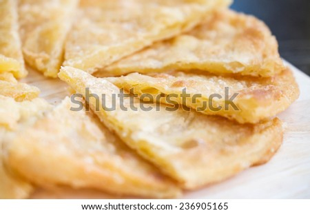 Delicious and crispy fried bread for light appetizer background - stock photo