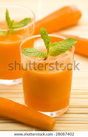 delicious and fresh carrot juice and mint - stock photo