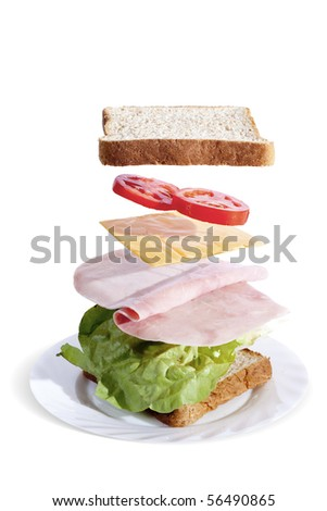 delicious and fresh ham sandwich separated by ingredients - stock photo