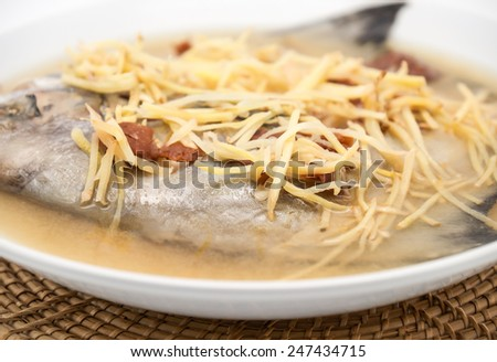 Delicious and fresh steamed butterfish with ginger herb for healthy food background - stock photo
