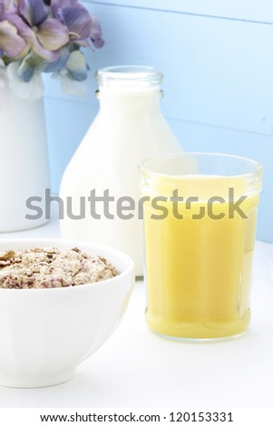 Delicious and healthy breakfast cereal with orange juice
