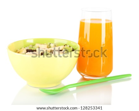 Delicious and healthy cereal in bowl with juice isolated on white - stock photo