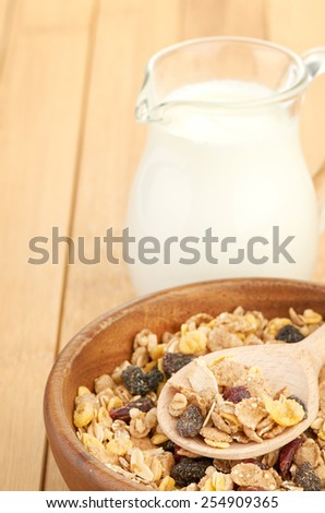 Delicious and healthy cereal in bowl with milk - stock photo