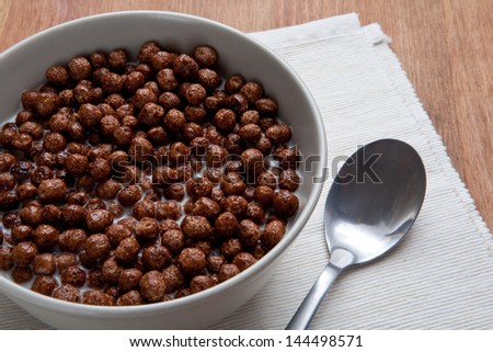 Delicious and healthy cereal in bowl with milk for breakfast - stock photo
