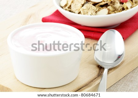 delicious and healthy cereal,  with strawberry yogurt and lots of dry fruits, nuts and grains - stock photo