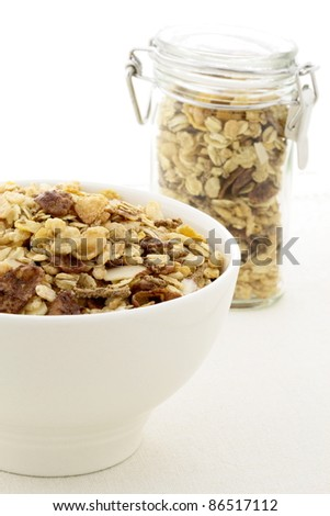 delicious and healthy chocolate cornflakes and almonds muesli or granola great nutritious food. - stock photo