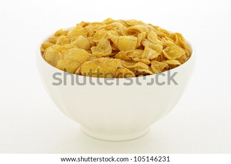 delicious and healthy  corn flakes, served in a beautiful French Cafe au Lait Bowl - stock photo