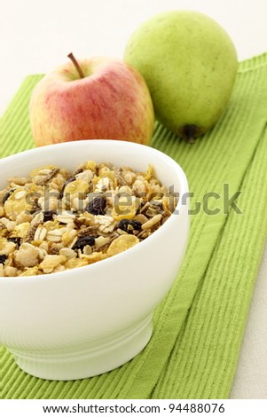delicious and healthy granola or muesli with fresh organic apple and pear , with lots of dry fruits, nuts and grains. - stock photo