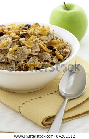 delicious and healthy granola or muesli with fresh organic apple, with lots of dry fruits, nuts and grains. - stock photo